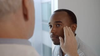 Cosmetic Surgeon In Consultation With Male Patient