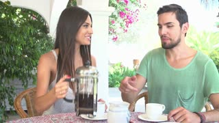 Couple Eating Breakfast Outdoors Together