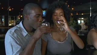 Couple Enjoying Drink At Bar Together
