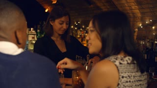 Couple Enjoying Night Out At Cocktail Bar, Slow Motion