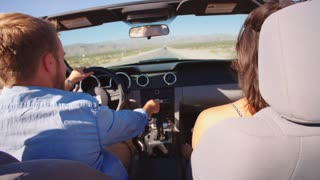 Couple On Road Trip Driving In Convertible Car Shot On R3D