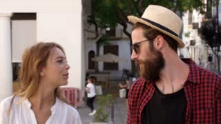 Couple on vacation talking as they walk through Ibiza town, shot on R3D