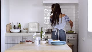 Couple preparing food together by the oven, shot on R3D