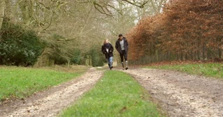 Couple Walking Along Path In Countryside Shot On R3D