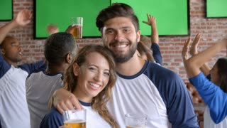Couple Watching Game In Sports Bar On Screens Shot On R3D
