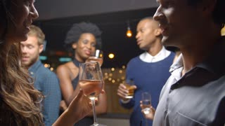 Couples Chatting And Drinking At Evening Party, Slow Motion