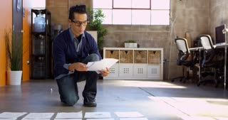 Designer Plans Layout On Floor Of Modern Office Shot On R3D