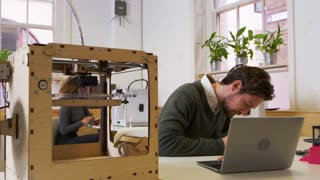 Designer working in a 3D printing lab, shot on R3D