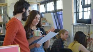 Designers Having Informal Meeting In Office