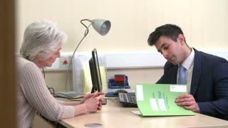 Doctor Discussing Test Results With Senior Female Patient