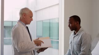 Doctor Meets With Male Patient In Exam Room Shot On R3D