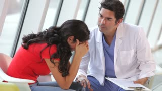 Doctor Talking With Depressed Female Patient