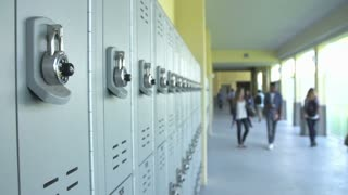 Dolly Shot Of High School Students Walking In Hallway