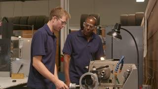 Engineer Training Male Apprentice On Lathe Shot On R3D