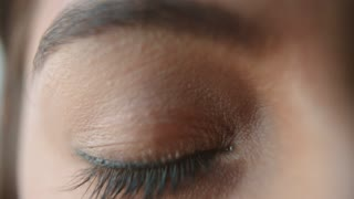 Extreme close up of a woman�s brown eye opening