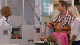 Family Going On Vacation Checking In At Airport Shot On R3D