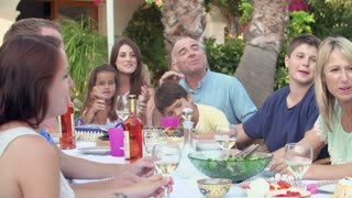 Family Group Celebrating Birthday On Terrace In Slow Motion