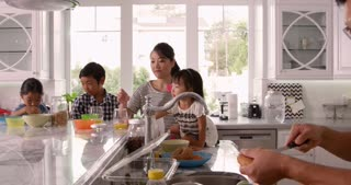 Family Having Breakfast And Making Lunches Shot On R3D