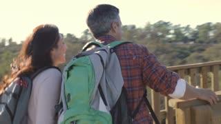 Family Looking Through Binoculars On Viewing Platform