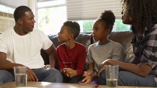 Family Sitting On Sofa Having Argument
