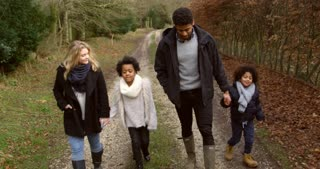 Family Walking Along Path In Countryside Shot On R3D