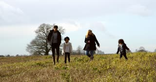 Family Walking With Dogs In Countryside Shot On R3D