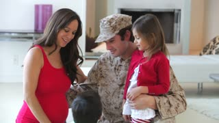Family With Pregnant Mother And Military Father