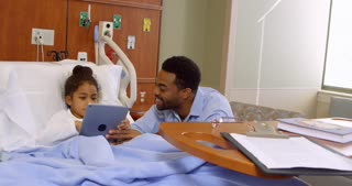 Father And Child Use Digital Tablet In Hospital Shot On R3D