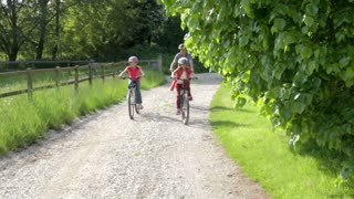 Father And Children On Cycle Ride In Countryside