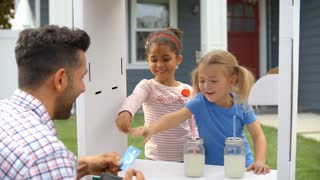 Father Buying Lemonade From Children's Stall Shot On R3D