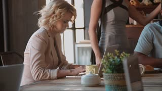 Female Customer In Coffee Shop Using Laptop Shot On R3D