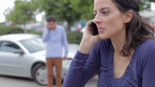 Female Driver Making Phone Call After Traffic Accident