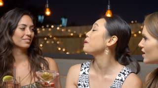 Female Friends Enjoying Night Out At Rooftop Bar Shot On R3D