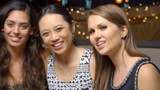 Female Friends Enjoying Night Out At Rooftop Bar, Slow Motion