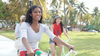 Female Friends Having Fun On Bicycle Ride