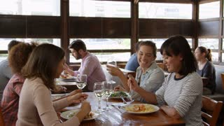 Female friends making a toast during lunch at a restaurant, shot on R3D