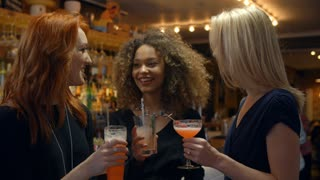Female Friends Meeting For Evening Drinks In Cocktail Bar