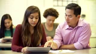 Female High School Student With Teacher Using Digital Tablet