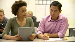 Female High School Student With Teacher Using Digital Tablet
