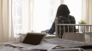Female Student Sitting At Desk And Working In Bedroom