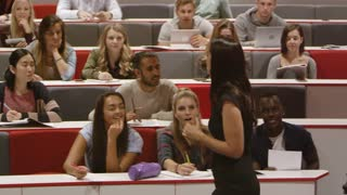 Female teacher talking with students in a lecture theatre, shot on R3D