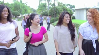 Female University Students Walking And Talking On Campus