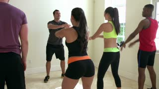 Fitness Instructor In Exercise Class