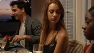 Friends at a dinner party on a roof terrace, close up, Ibiza, shot on R3D