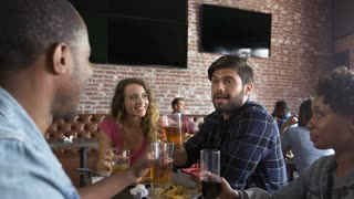 Friends Eating Out In Sports Bar With Screens Shot On R3D
