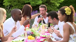 Friends Enjoying Outdoor Dinner Party Together