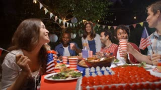 Friends Making A Toast To Celebrate 4th Of July At Party