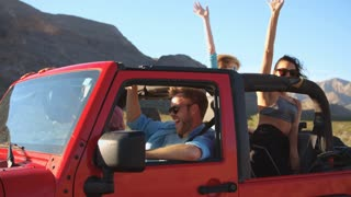 Friends On Road Trip Driving In Convertible Car Shot On R3D