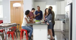 Friends socialising in a kitchen, waist up, shot on R3D