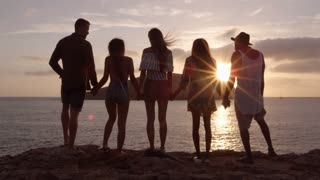 Friends Standing On Cliff Watching Sunset Shot On R3D